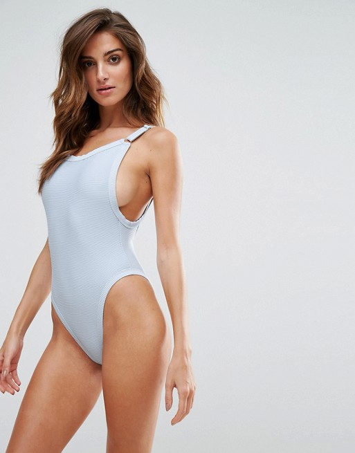 Woman in one-piece grey swimsuit from Asos