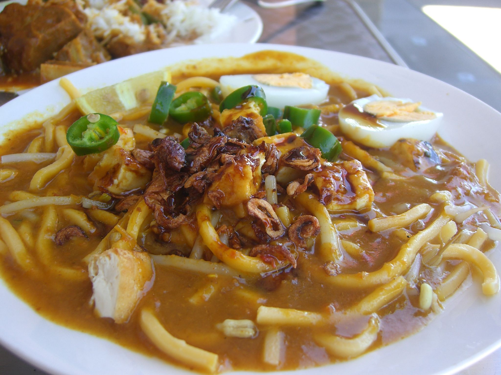 mee rebus thick yellow egg noodles brown gravy fried shallots hard boiled egg singapore malaysia traditional hawker street food
