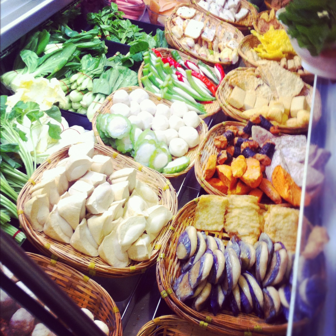 yong tau foo stall display various items vegetables meat colourful singapore malaysia traditional street food hawker