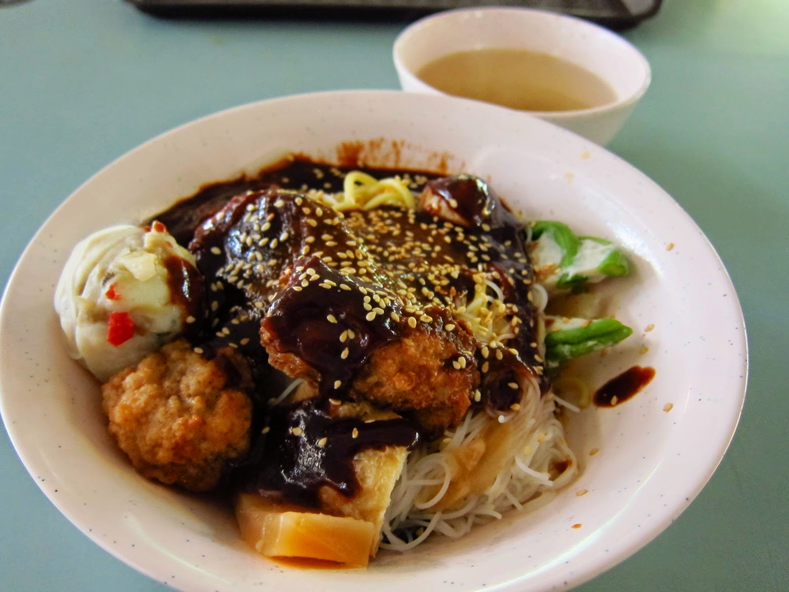 yong tau fu meatballs dry vermicelli sweet brown sauce sesame seeds singapore malaysia traditional hakwer street food
