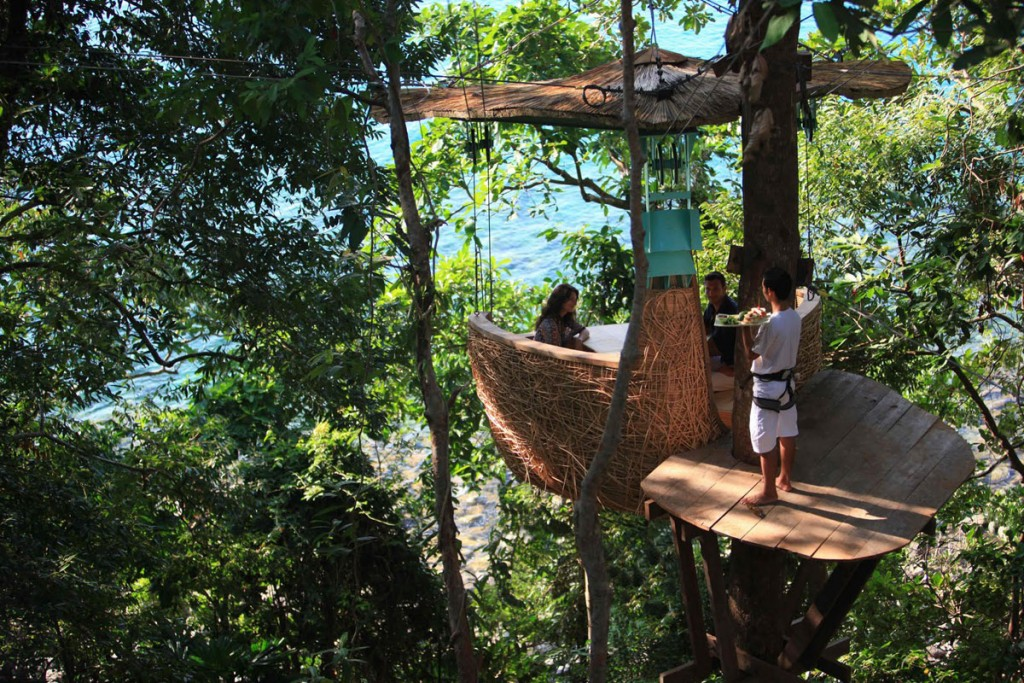 At the Soneva Kiri Eco Resort in Thailand, guests have the option to dine in a lofty woven Tree Pod perched 16 feet off the ground.