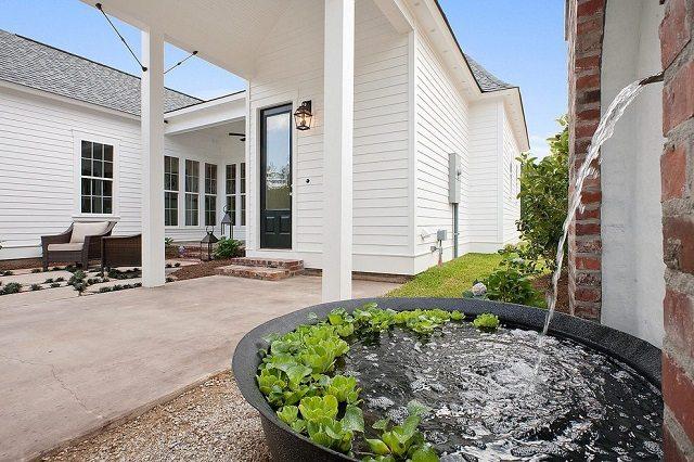 7 Air Mancur Dinding Batu Alam Membuat Rumah Lebih Sejuk