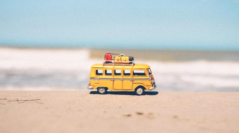 Miniature yellow buss on the beach