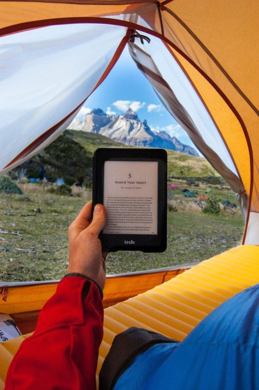 reading on kindle outdoors