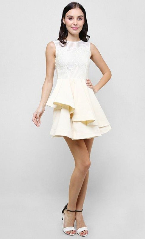 The mini-length lace cocktail dress in cream