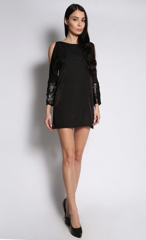A little black dress with a boat neckline and slashed sleeves
