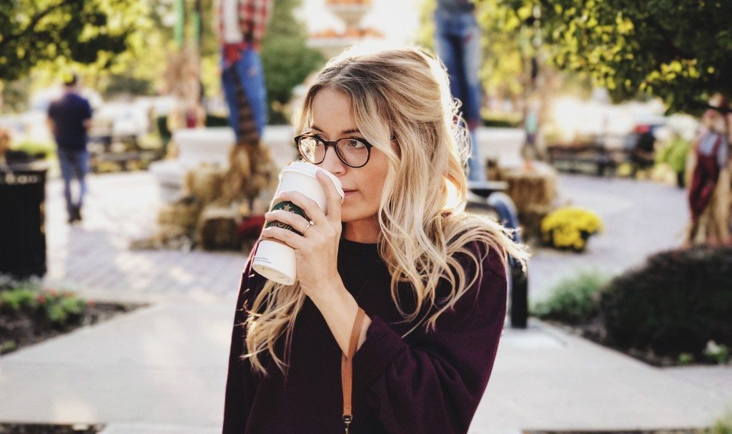 Woman holding Starbucks