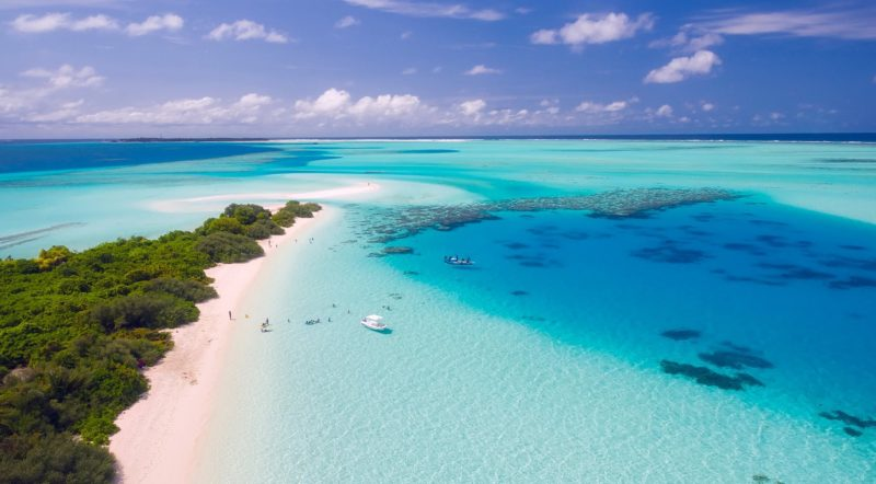 Island surrounded by clear waters and white sand
