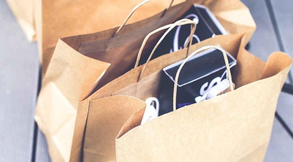 Brown paper shopping bags loaded with items