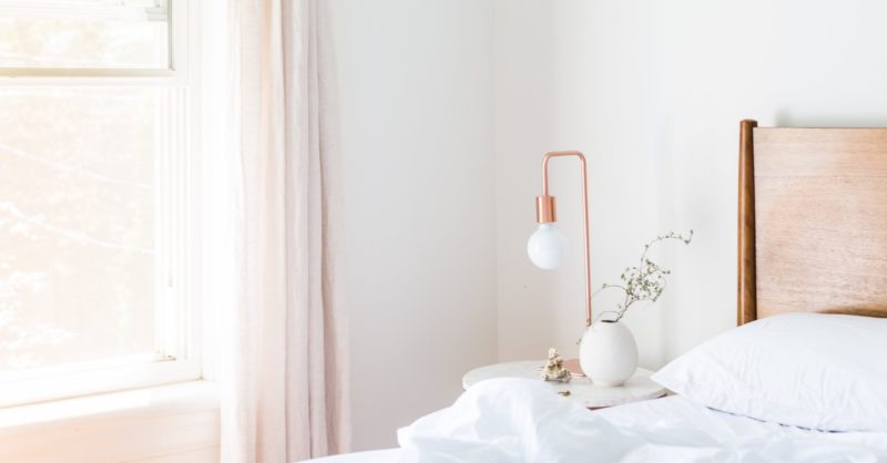 Hotel room with bright lights and rosy colored theme