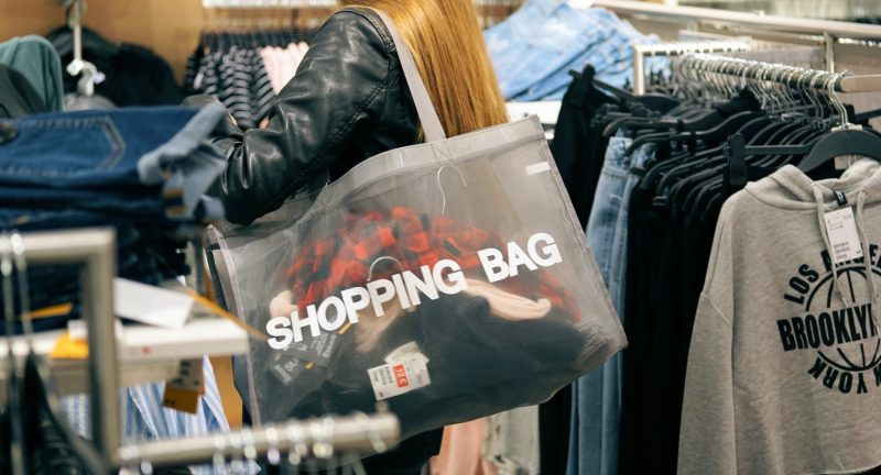 Woman with shopping bag in store