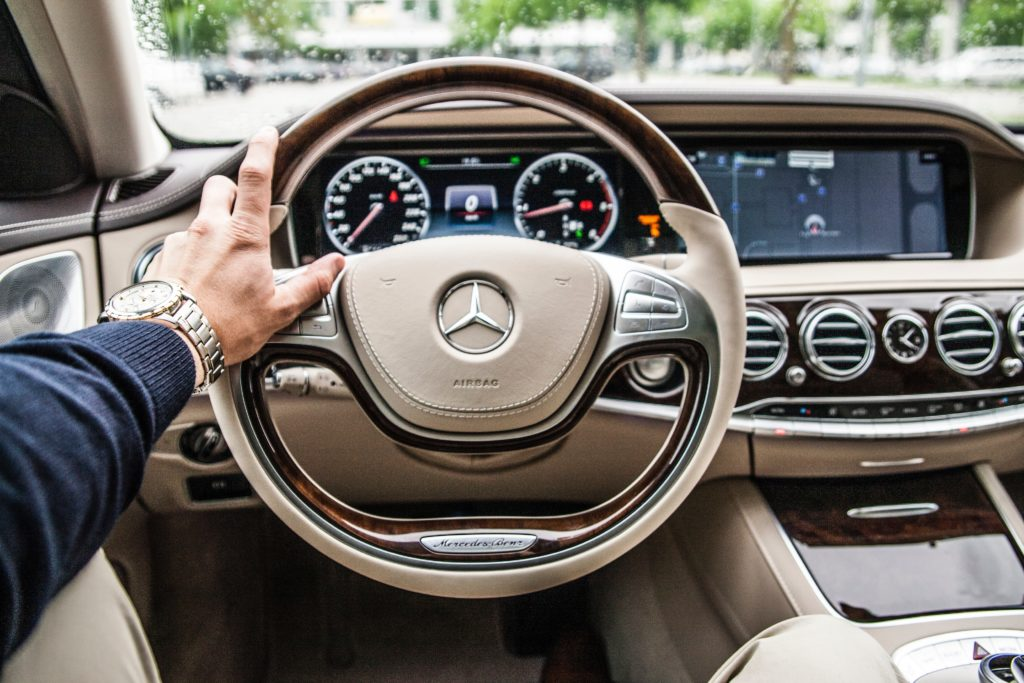Driving a Mercedes-Benz Car
