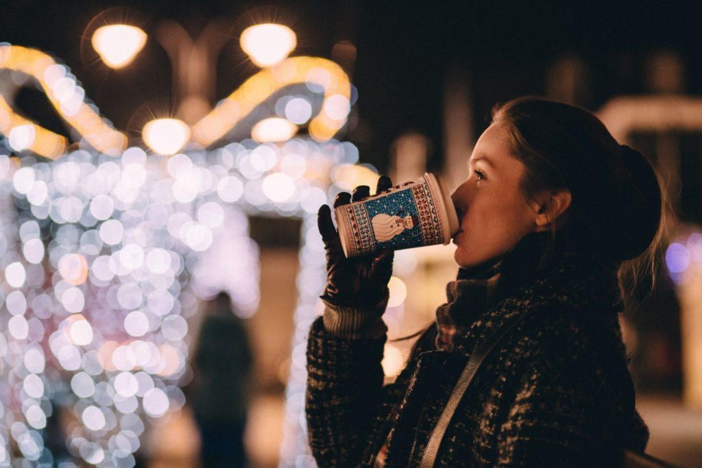 girl drinking hot drink in christmas winter