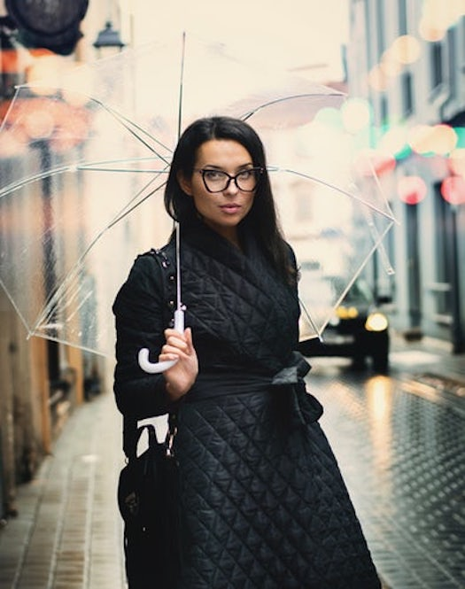 black fashionable winter quilted coat with umbrella