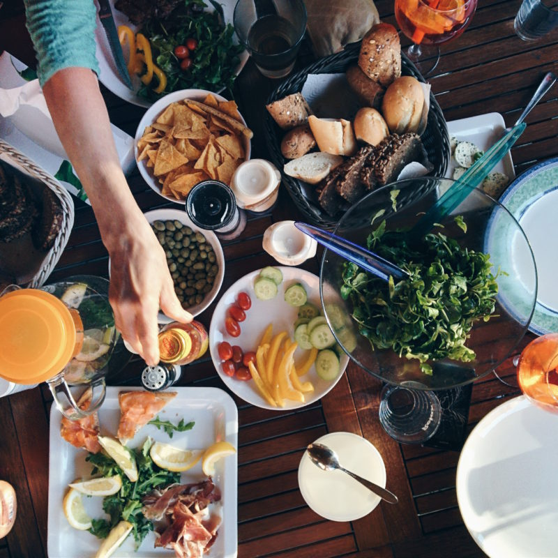 Barbecue feast with a spread of salads and roasts
