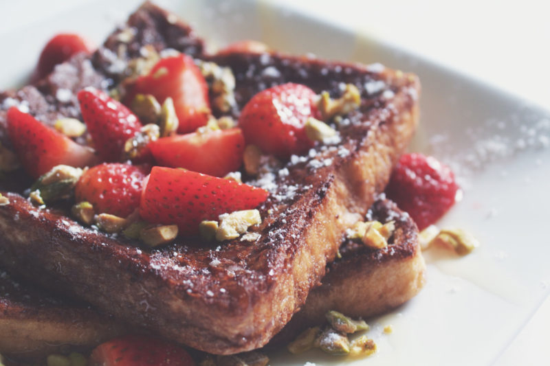 Milo French Toast with strawberries and chopped nuts