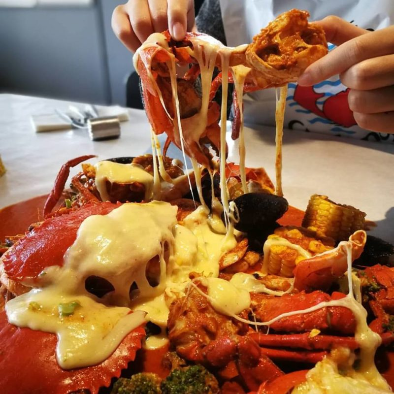 Cheese topping on seafood at Crab Factory, SS2