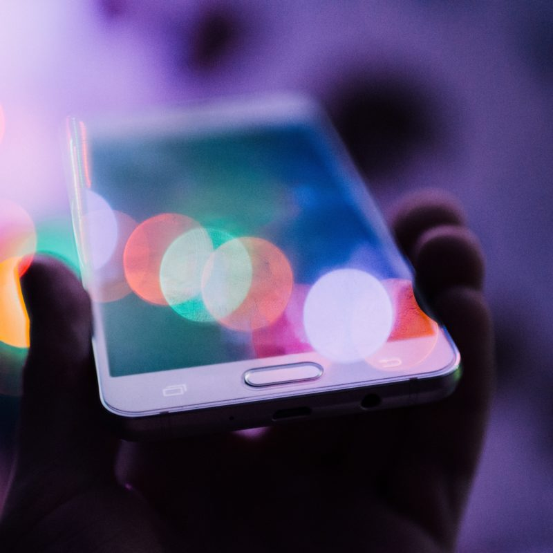 phone in bokeh lights
