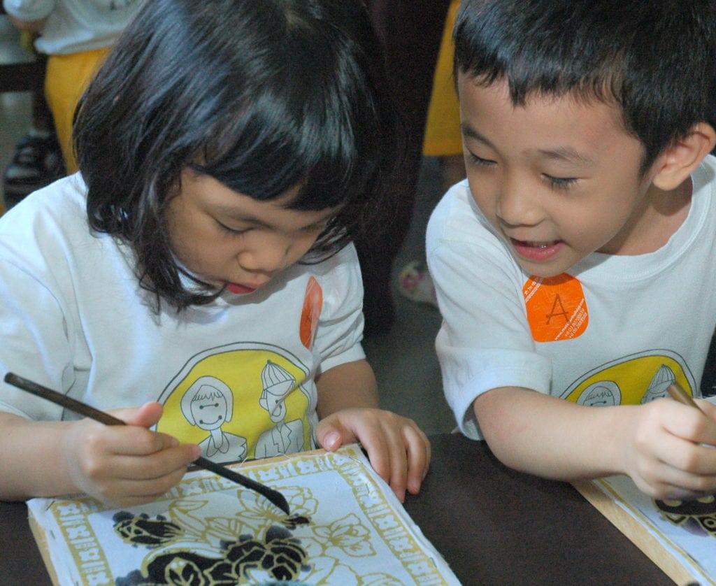 Kids enjoying a batik painting session