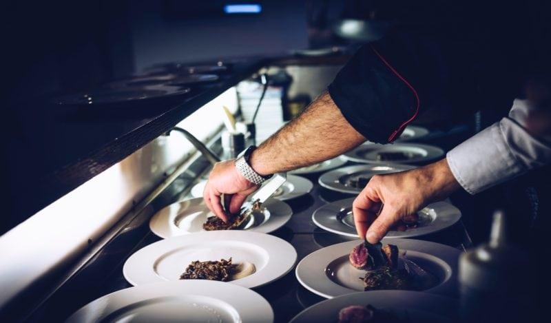 chef putting garnish in restaurant