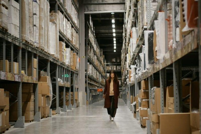 woman walking in storage