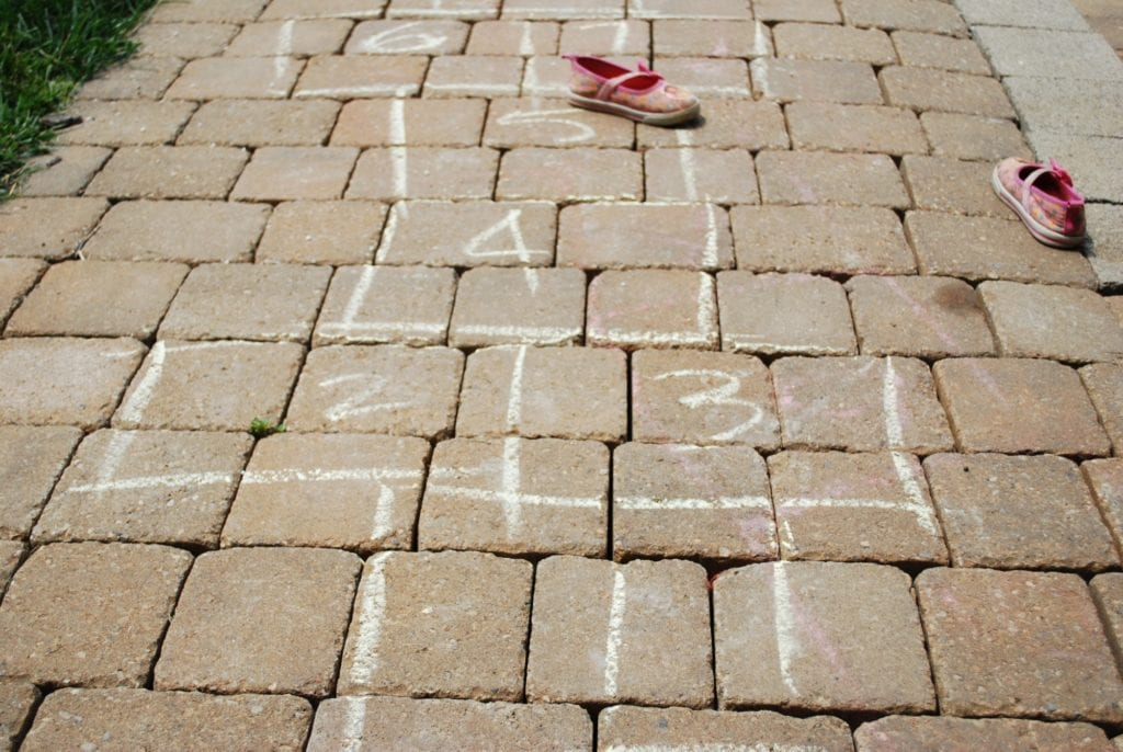 hopscotch on stones with 2 oink shoes on side