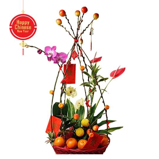 Flowers and oranges hamper in decorated basket