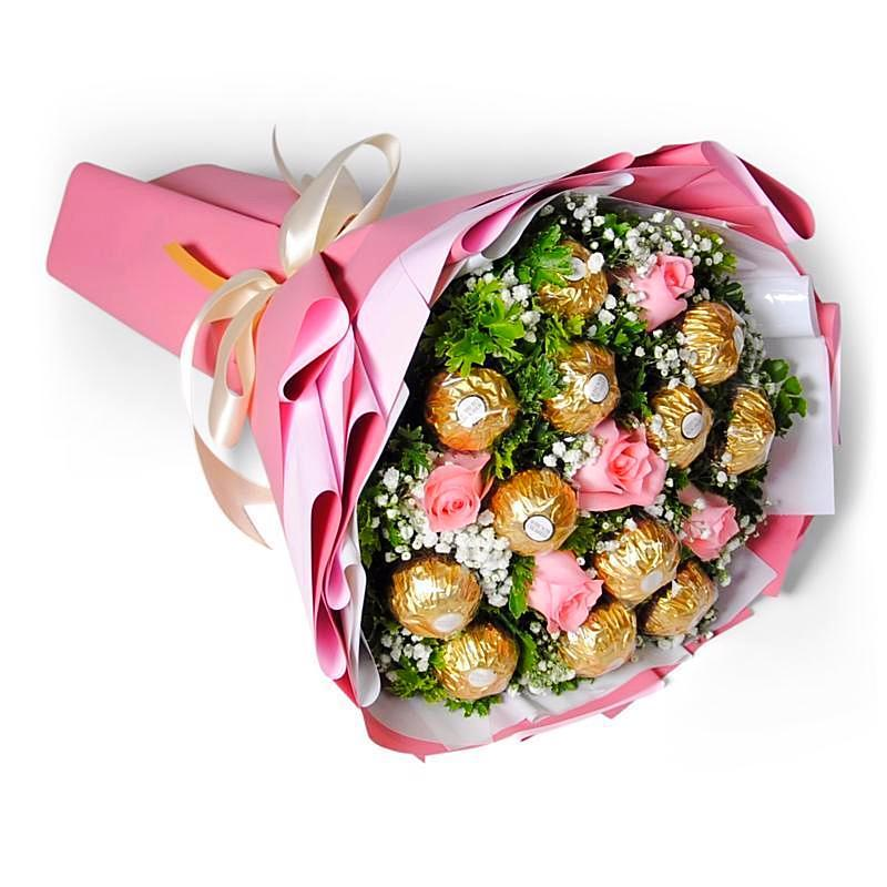 bouquet of flowers and chocs in pink wrapper