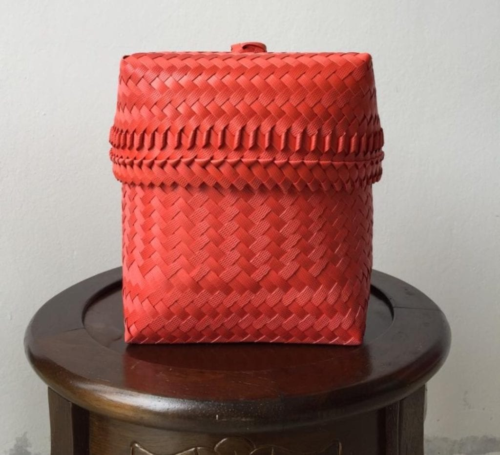 hand woven red basket on stool