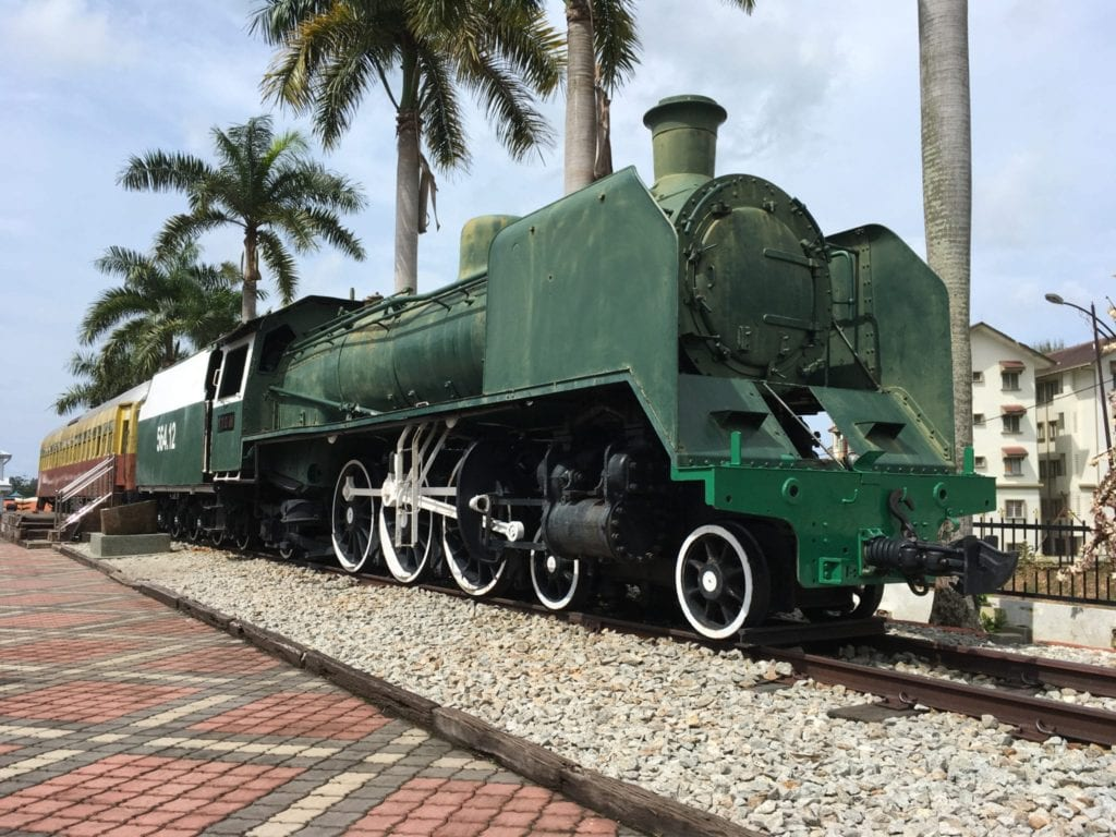 green train on the museum grounds