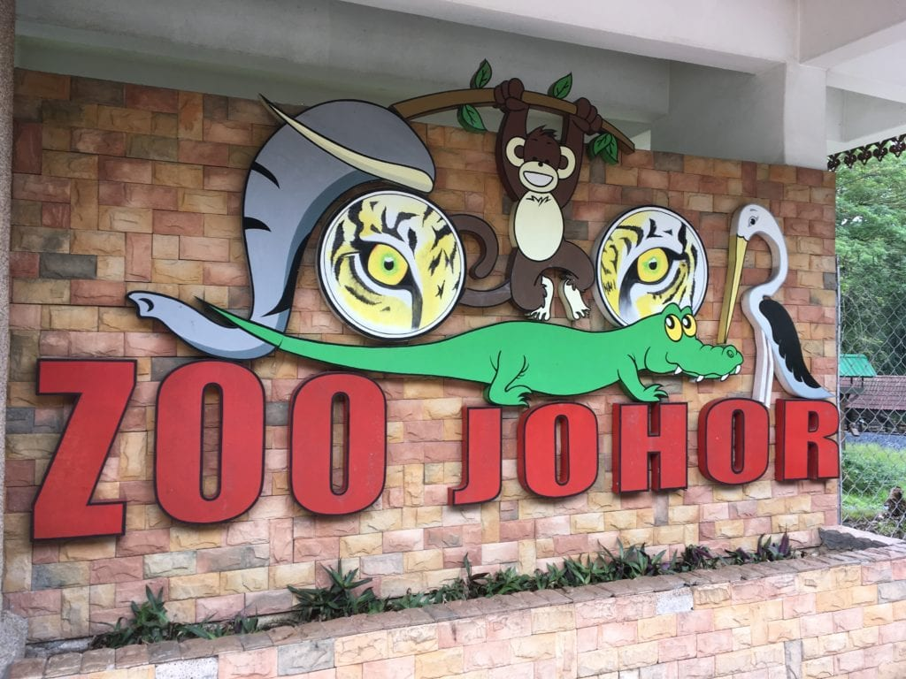 Front entrance to Johor Zoo with mural on brick wall