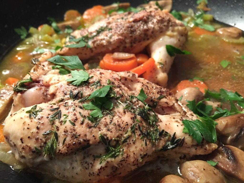 chicken stew in borwn gravy with parsley sprinkles