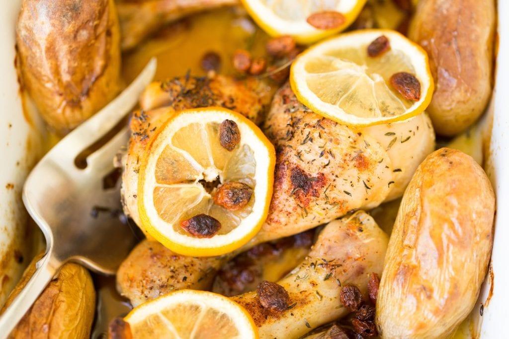 lemon chicken with lemon slices and fork