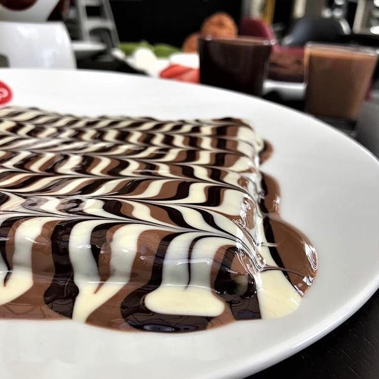chocolate crepe with light, dark and milk chco stripes on top