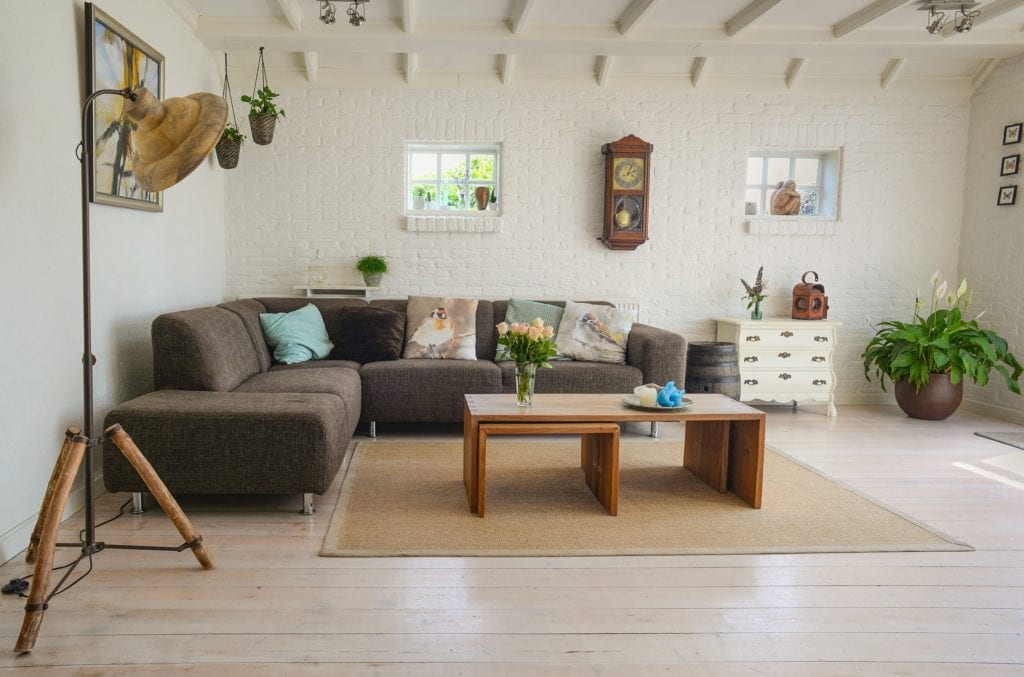 Living room interiors with wooden coffee table and sofa
