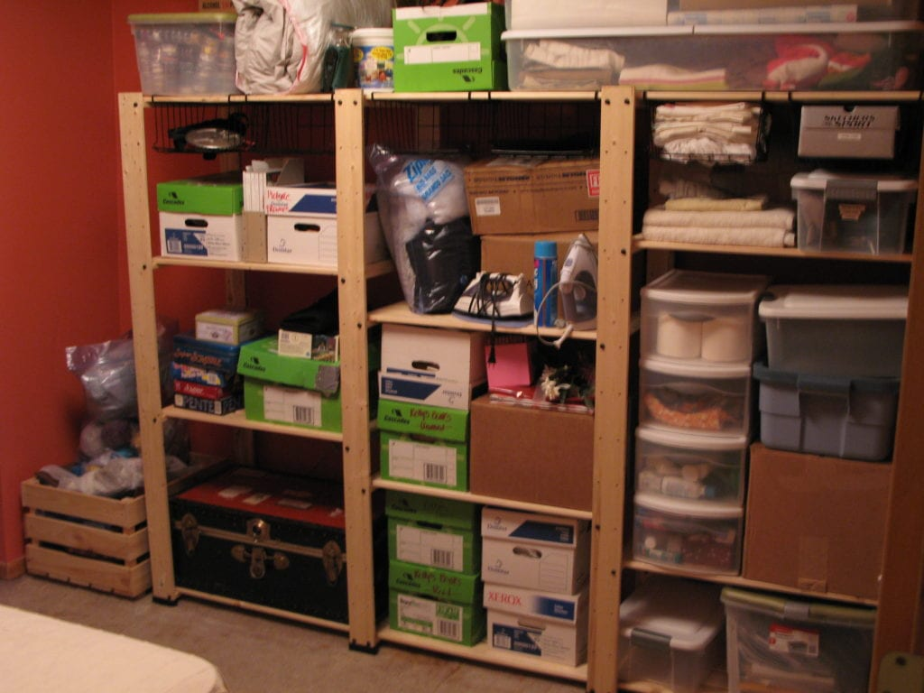 Storage boxes on shelving units in storage room