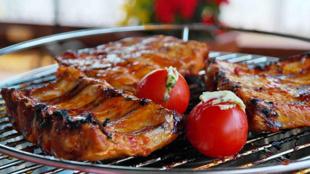 BBQ grilled meats with tomatoes