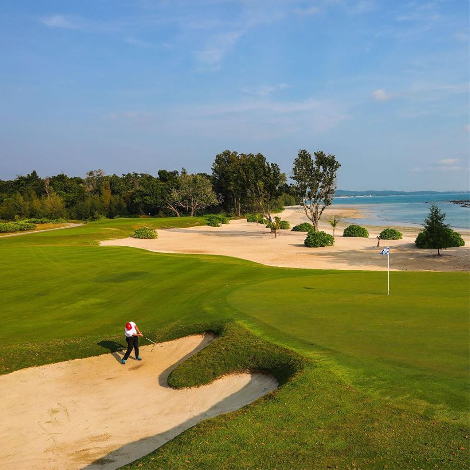 The Ocean Course facing the sea with one golfer in bunker