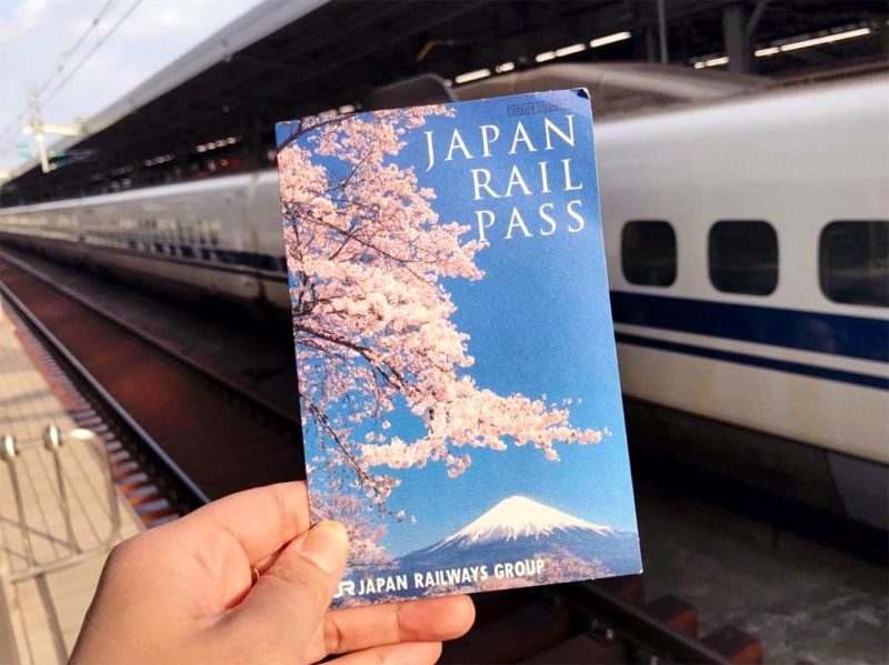 hand holding Japan Rail Pass
