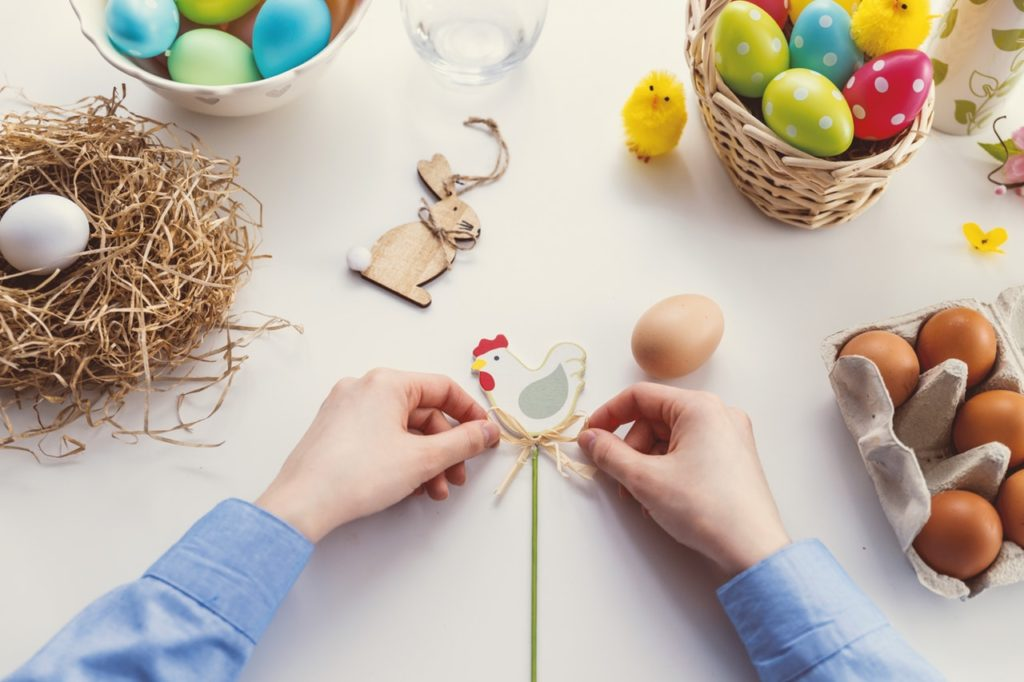 Easter crafting with 2 hands doing craft
