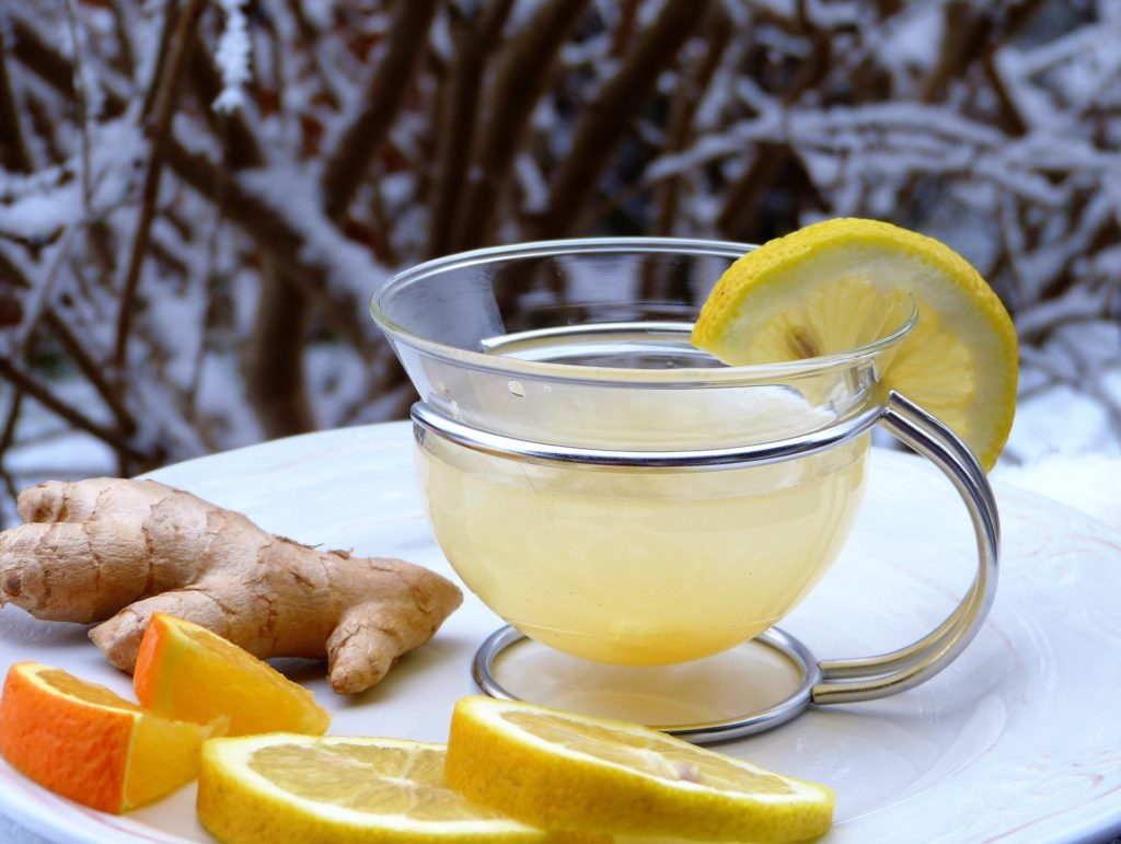 ginger tea in cup with lemon slices around