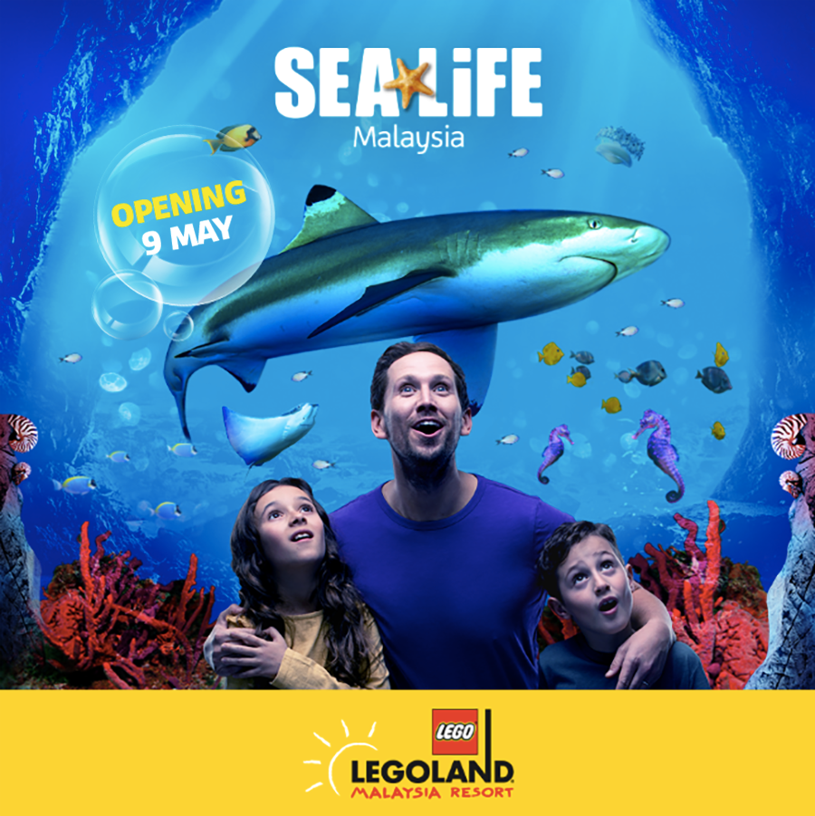 SEA LIFE poster with a father and 2 kids at centre