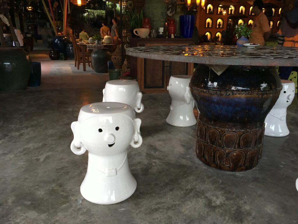 Cute ceramic chairs with faces on them