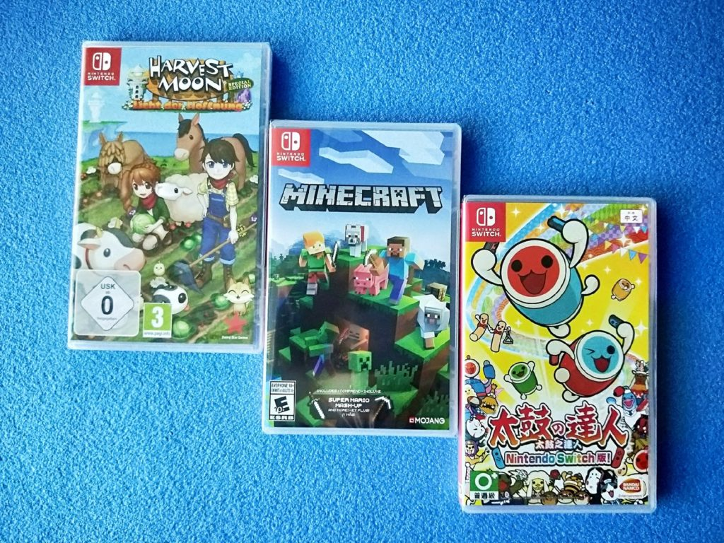 3 games covers on blue background