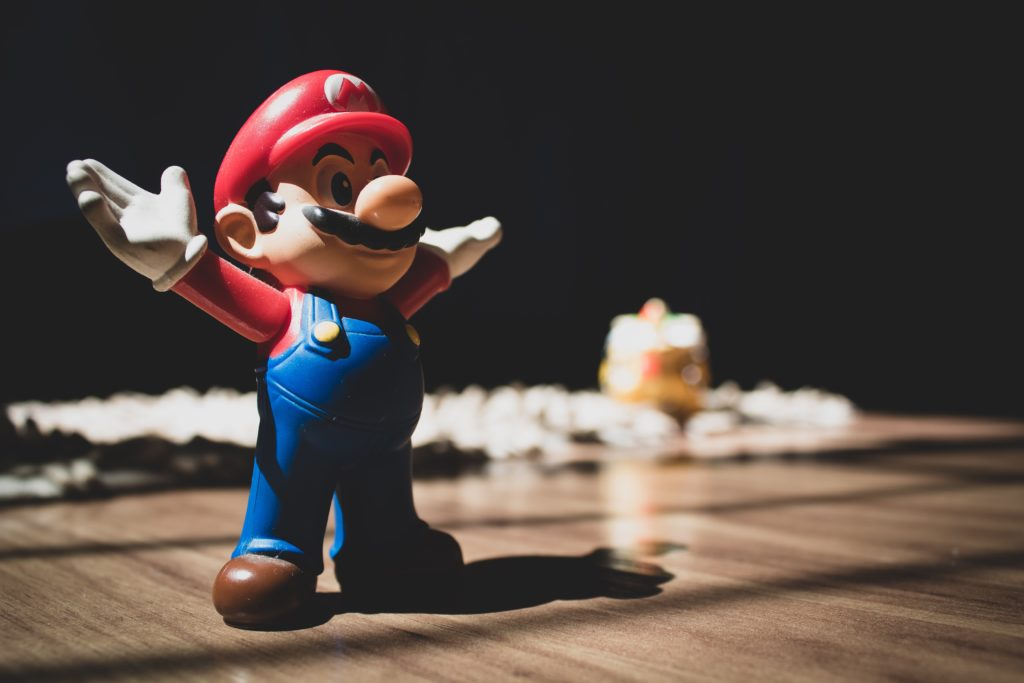 Super Mario toy on table