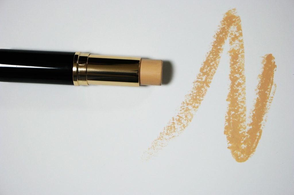 Concealer stick making a zig zag mark on white top