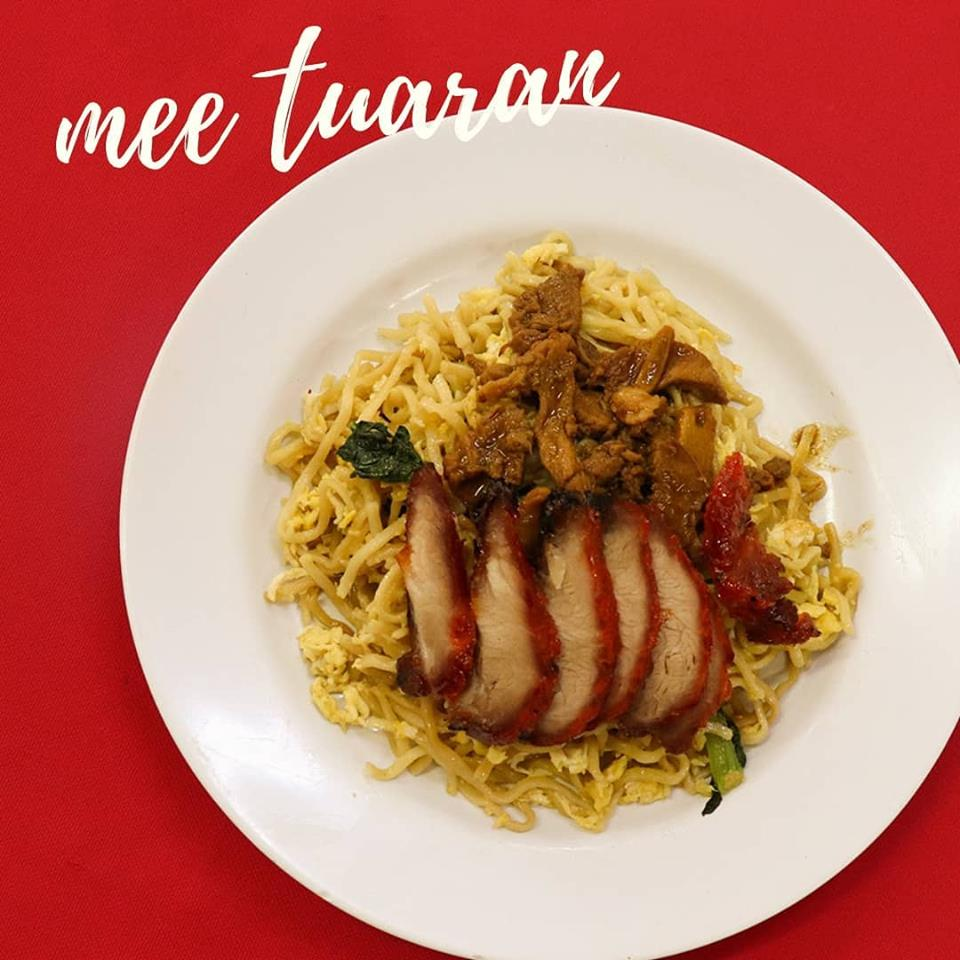 Mee Tuaran on white plate with red background