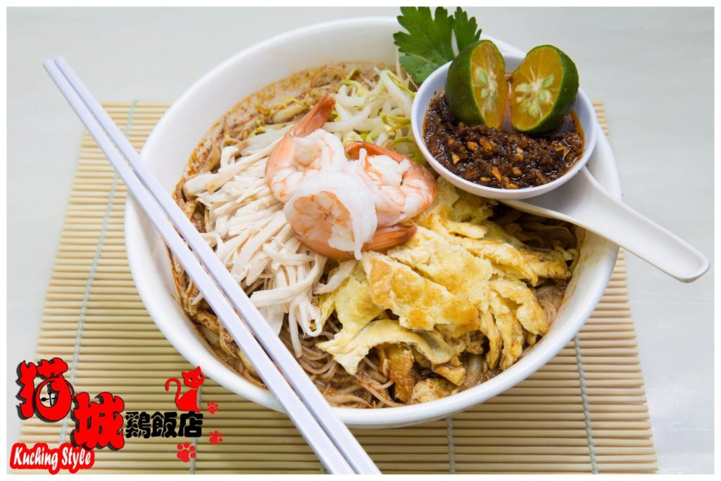 Sarawak Laksa in white bowl with white chopsticks on top