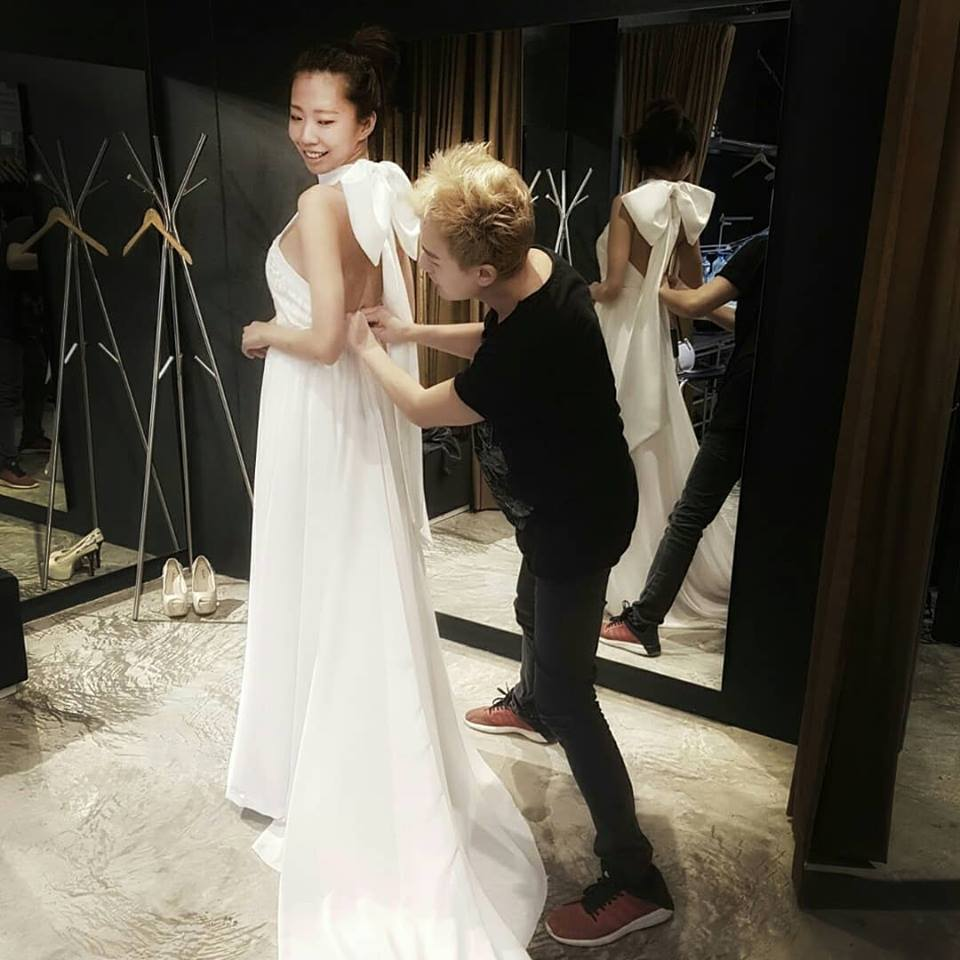 Jimmy Lim designing bridal wear with bride in front of mirror