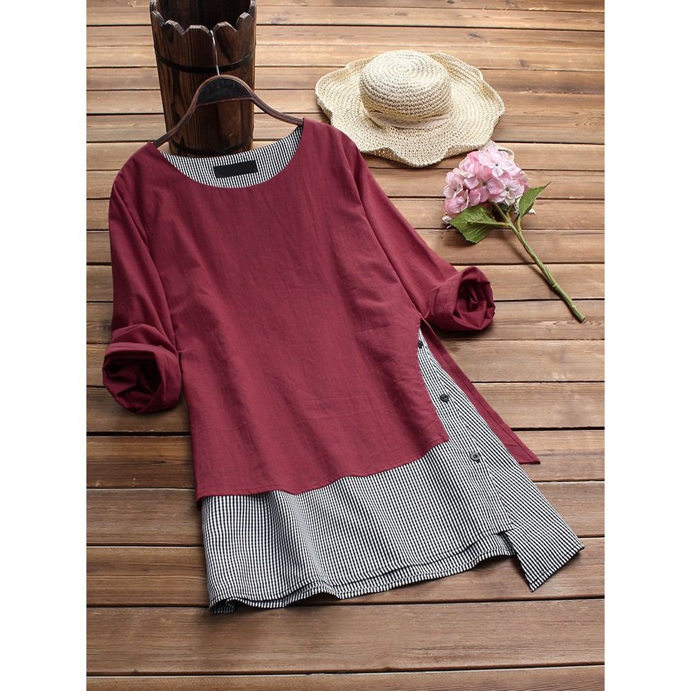 Maroon and grey top next to white hat and pink flower on wooden floor